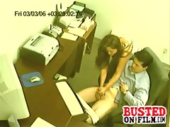 Perverted boss sets up spycam to film his office girl giving him a handjob.