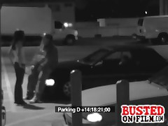 Parking lot guard gets a BJ in exchange for not calling police and is all caught on security cam!
