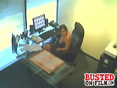 Chick is busted on office spy cam fingering her pussy at the bosses desk and he sees she uses his office supplies as dildos.