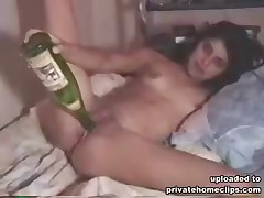 Damn! This classy bimbo is really insatiable! She is heavily working the big bottle inside the pussy while the home camera is recording her kinky but exciting action!