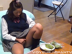 Home from school, we look in on this young cutie. With their way mom in the kitchen, the girl has their way snack on the couch. Our VoyeurJapanTV.com camera films as the snack soon becomes a